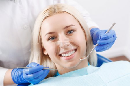 Pretty blond woman during her dentist visit
