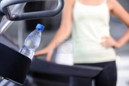 Fit   woman with bottle of water