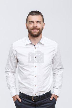 Man with beard standing