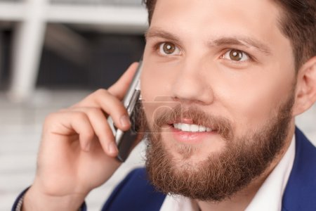 Close up of man talking per cell phone