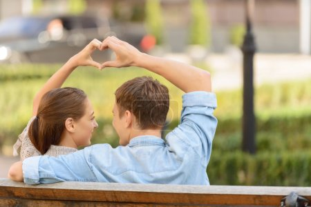 Nice young couple sitting on the bench