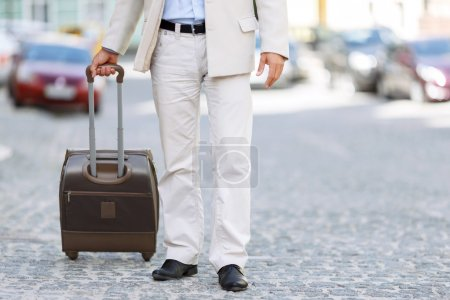 Hansome man holding his travel bag