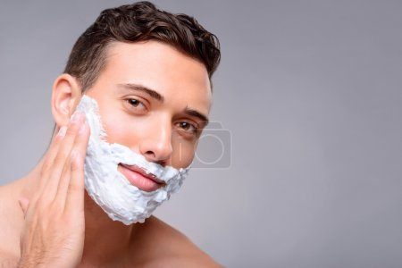 Pleasant guy shaving