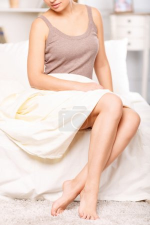 Pleasant girl resting in bed