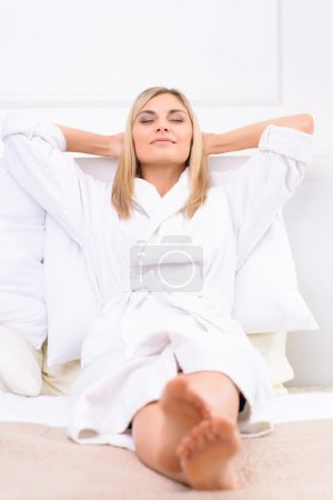Attractive woman contemplating in her bed.