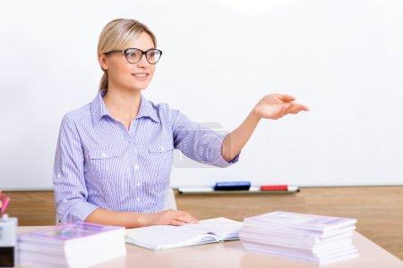 Teacher sitting at the desk