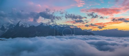 Photo for Sunset over cloudy valley at Caucasus mountains - Royalty Free Image