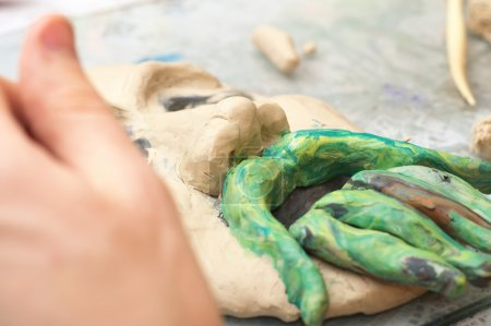 Ssculpting with plasticine