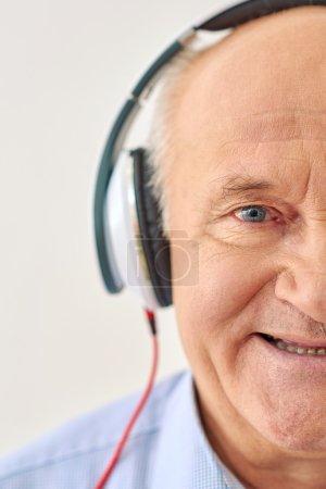 Grandpa listens to music