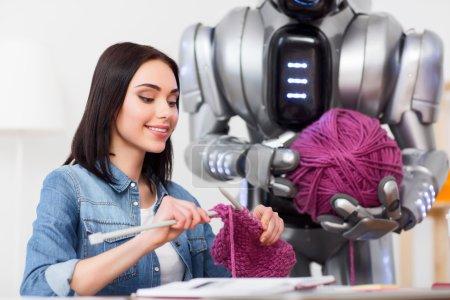 Pleasant girl knitting
