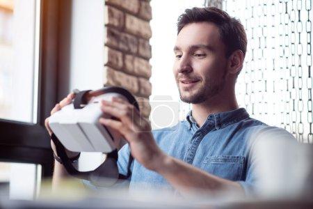 Pleasant man using virtual reality device