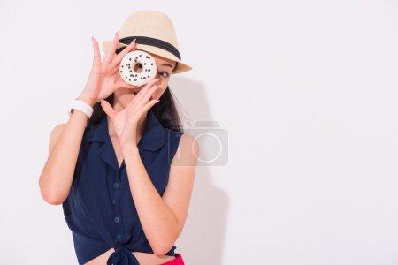 Pleasant positive woman holding donut