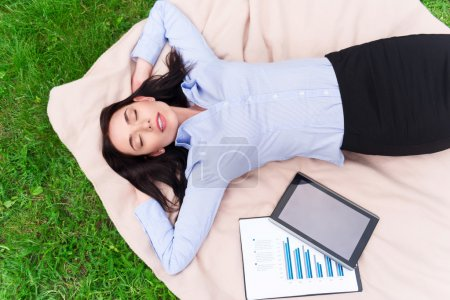 Relaxed delighted woman resting on the blanket