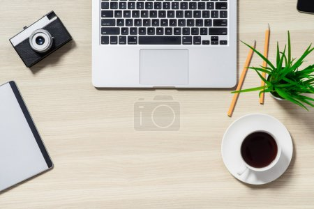 Modern life. Lay out of table with laptop and cup ...