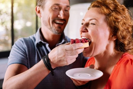 Woman tasting a delicious cake