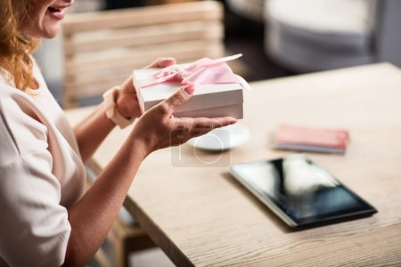 Nice woman holding wonderful present