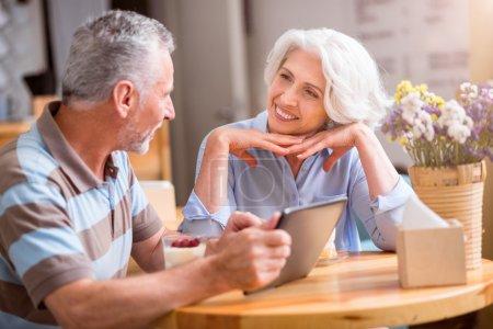 Cheerful senior couple talking
