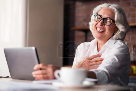 Caucasian woman being happy using computer for family communication