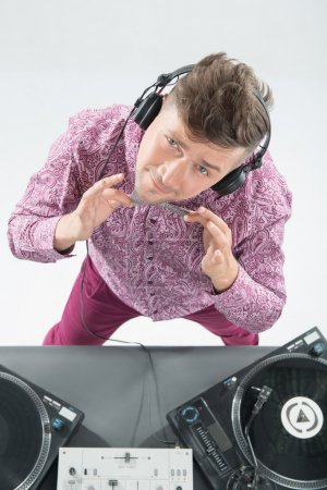 Top view portrait of dj mixing and spinning turntable