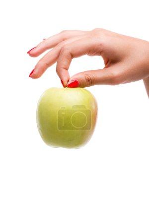 Woman  holding ripe green apple