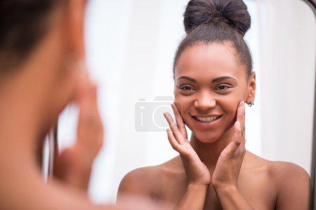 Beautiful  dark skinned girl in white towel