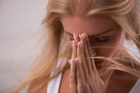 Girl praying looking aside