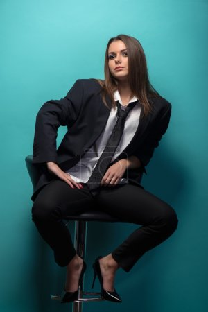 Young woman wearing suit