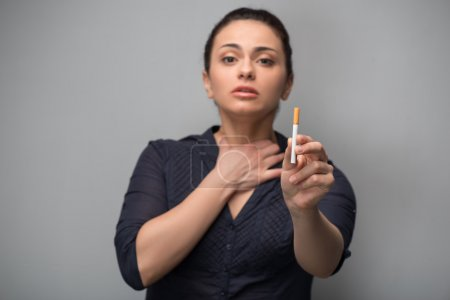 Determined woman with cigarette