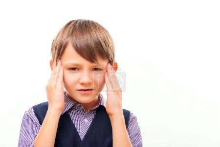 Cute child suffering from headache