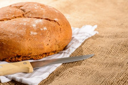 Image of bread loaf and knife
