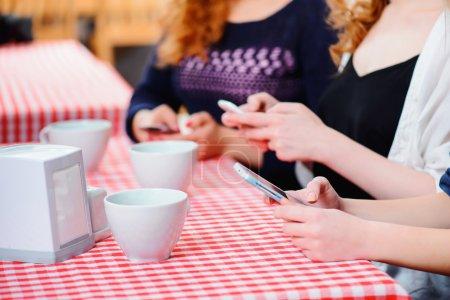 Female friends printing sms