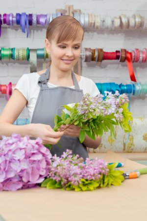 Florist work with flowers