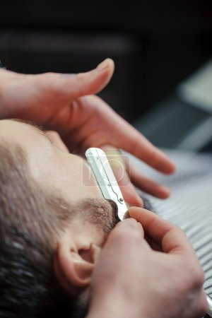 Old-fashioned male shaving