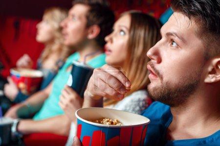 Impressed cinema viewers with popcorn