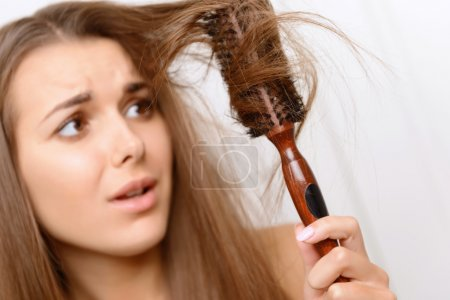 Photo for Totally upset.  Girl having problems with her matted hair - Royalty Free Image