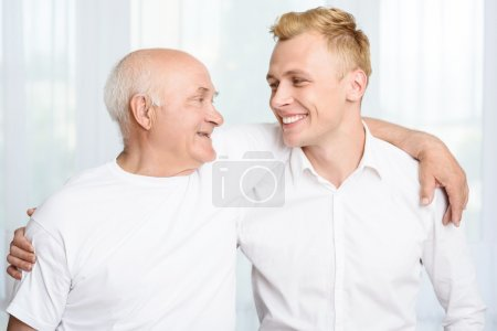 Grandfather and grandson embracing each other