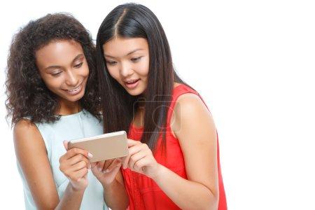 Pleasant girls holding smart phone.