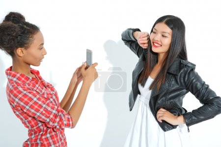 Laughing girls taking photos