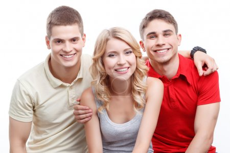 Happy company. Smiling young blond-haired woman an...