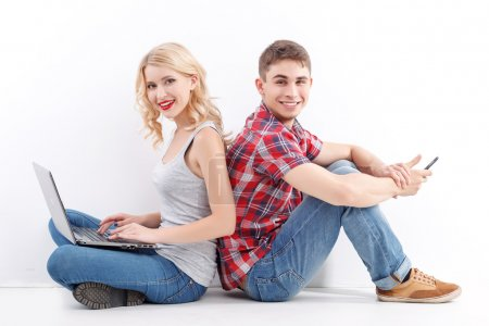 Man and woman with mobile phone, laptop