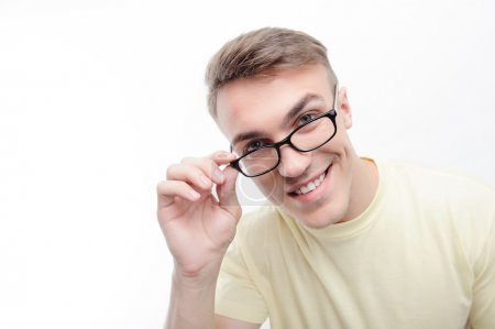 Close up of smiling man wearing glasses
