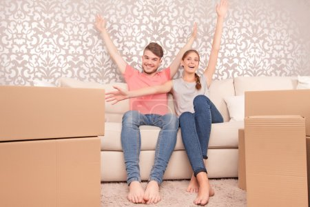 Young couple siting on sofa