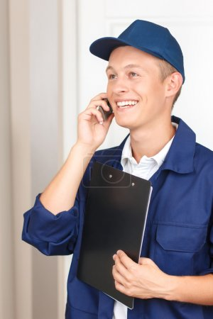 Deliveryman talking on mobile phone