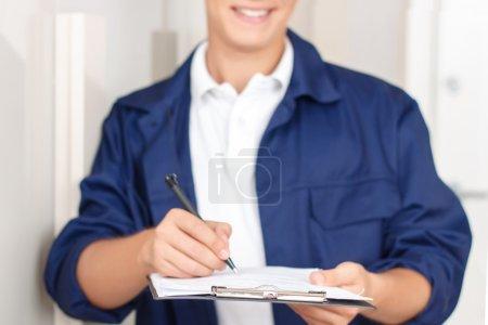 Deliverymen signing paper