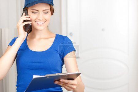 Delivery woman talking on mobile phone