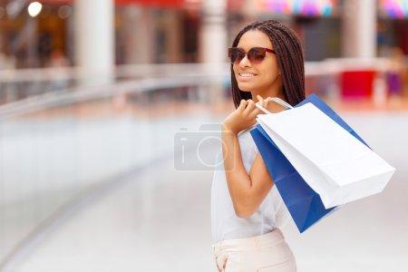 Pleasant girl making shopping