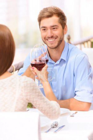 Loving couple drinking wine