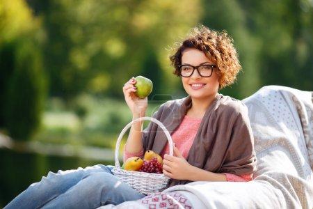 Nice girl holding fruits