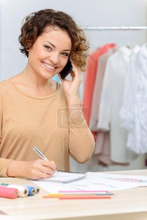 Cheerful designer making notes