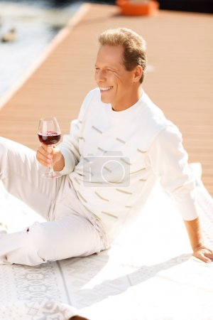 Pleasant man drinking wine
